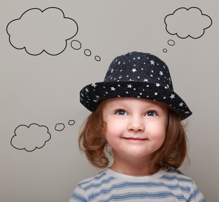 Child with a thought bubble